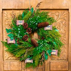 A festive and flavorful holiday wreath | http://www.ghirardelli.com/store/shop-products/collections/peppermint-bark/milk-peppermint-bark-50-count-squares-chocolates-gift-bag.html?utm_source=pinterest&utm_medium=social&utm_campaign=peppermintbark