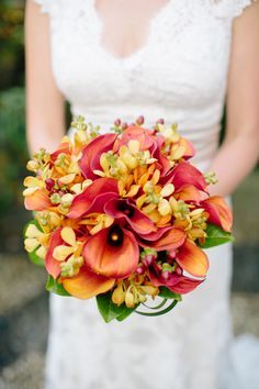 Colorful bouquet from Clark's House of Flowers - clarkshouseofflowerssi.com. Photography: Angela Newton Roy - angelanewtonroy.com  Read More: http://www.stylemepretty.com/tri-state-weddings/2014/04/11/colorful-botanic-garden-wedding/