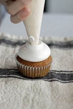 Cloud frosting...a cross between marshmallow and whip cream. Add coconut extract for pineapple cupcakes!