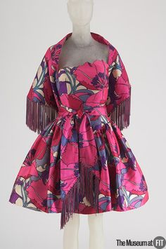Liberty of London ,1961. printed silk dress and fringe. USA. Born Arnold Isaacs, Arnold Scaasi worked as an assistant to Charles James in the early 1950s. Museum at FIT New York.
