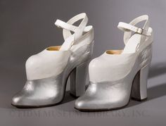 Mae West  (1893-1980) was only about 5 feet tall. To increase her stature, West usually wore shoes with extremely high-heels, both onscreen and off. Though the shoes were usually hidden by the long dresses she wore, West made sure her footwear was glamorous, as demonstrated by the platform heels below. Together, the heel and platform measure 9 1/2 inches!!