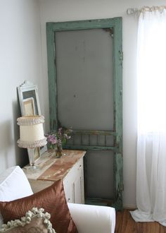 old screen door, just propped in a corner. keep it simple. Uhm. I'm in love with this!!!