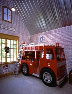 Awesome room for a little boy. The fire truck is a bed!!