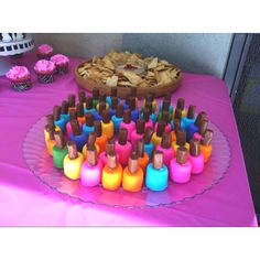 Having a girls night? Try this.  Nail polish bites - marshmallows dipped in frosting and topped with a tootsie roll... So cute for a little girls party too!