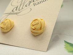 ooo...Rolled fabric flower studs. Would it be too much to wear homemade earrings with a homemade headband? lol.