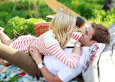 adorable engagement photo! loving her red and white striped dress, skinny belt, his light outfit and watch plus a picnic theme :)