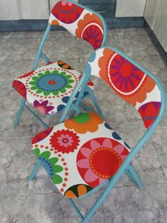 Upcycled folding metal chairs spray painted and covered in ikea material