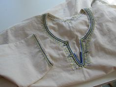 Trim around the neckline is simply amazing: It's stem, and chain with satin stitch over the bottom of the yoke.