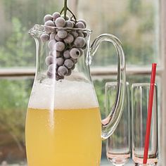Fizzy Drink Recipes—Keep Sparkling Grape Juice-Lemonade cold with frozen grapes―they add pizzazz without diluting the flavor.    SouthernLiving.com