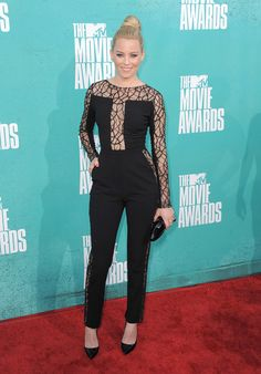 "Elizabeth Banks of ""The Hunger Games"" walks the red carpet at the 2012 MTV Movie Awards in a sleek one piece. She would make a good Catwoman.    Photo Credit: AP Photo"