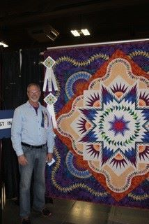 Glacier Star designed by Quiltworx.com, made by Joseph Stroman, and quilted by Vicki Ibison.  Won Best in Show.