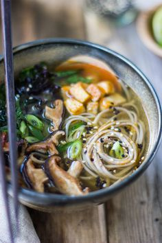 {Miso and soba noodle soup with roasted sriracha tofu and shiitake mushrooms.}