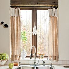 industrial faucet, with light curtains. dark raw wood trim