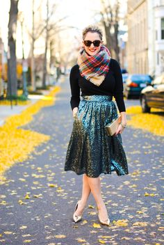 Holiday party perfection: sequinned skirt + sweater + plaid scarf.