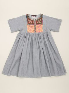 Look at this adorable little dress!