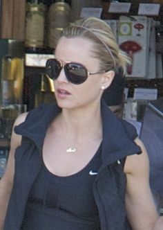 Mena Suvaris casual pulled back hairstyle