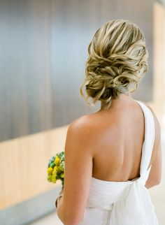 Side swept curly updo