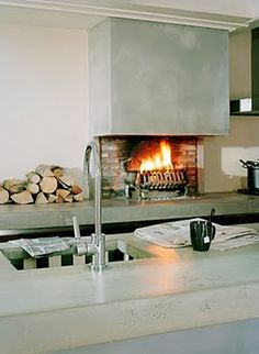 Concrete kitchen with fireplace.
