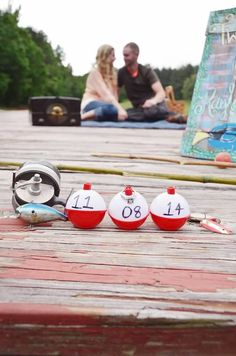 A.S.W. Engagements: Vintage Fishing Themed  Props: Old blue tin tackle box, bamboo fishing rods, bobbers with the save the date,  a cute puppy.