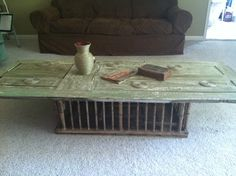 Old wooden door and chicken crate turned into a coffee table. Super easy and cheap!