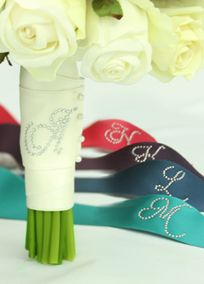 "Wrap your bouquet in this beautiful personalized satin bouquet ribbon, in your choice of exclusive David's Bridal colors, finished with your initial in rhinestones. Features and Facts:   Choice of rhinestone script initial.  Ribbon measures 30"" x 2"". View Rhinestone Lettering View Ribbon Colors"