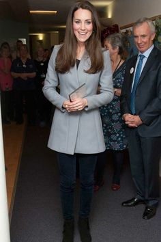 Kate Middleton in a Reiss jacket during a visit to Shooting Star House Children's Hospice. December 2013.