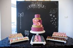 cake table with a chalkboard backdrop, photo by Darrin Hackney Photography http://ruffledblog.com/second-notwedding-wichita #weddingcake #desserttable #caketable