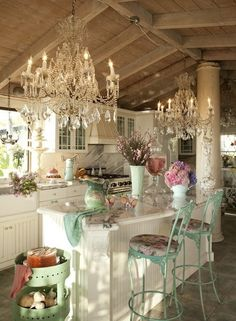 such a pretty kitchen.. and the chandeliers are unexpected!