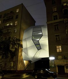 The amazing 'parasite office' designed by and for moscow-based za bor architects is a foreign contemporary object taking up the  space between two established buildings.
