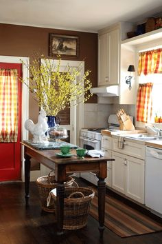 After painting the kitchen walls brown, Kirkpatrick accessorized the room with bright accents, including plaid curtain panels and a red door.