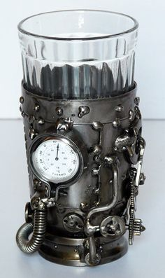 Steampunk glass holder with temperature gauge.