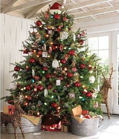 love the topper on the tree, the galvanized tubs, and the reindeer. Pottery Barn.