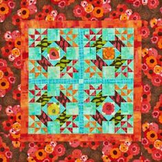 Sew a flowery springtime wall hanging by fussy-cutting a detail from your favorite big floral print.