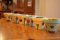 Handpainted pots done by children!  A great craft project!