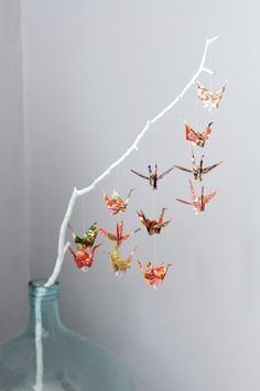 Paper cranes on branch