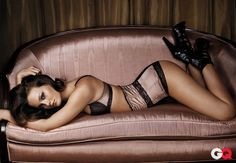 Obsession of the Year: Movies + TV: GQ. Lingerie. Sexy pose on couch.
