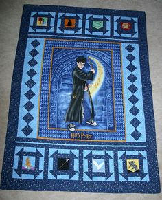 Harry Potter quilt made using patterns from http://fandominstitches.com surrounding a licensed HP fabric panel.