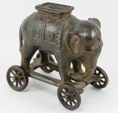 Cast Iron Antique Still Elephant Bank on Wheels