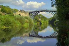 Iron Bridge, Telford, England. Opened in 1781, the Iron Bridge is the defining symbol of the Industrial Revolution. It was the world's first cast iron bridge, built using iron made in the nearby blast furnace, a feat made possible only by the flowering of coke-powered industry in this area.