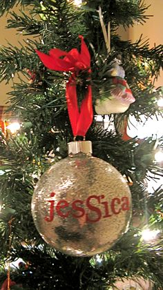 glitter ornament - use spray glue inside clear glass ornament. pour in loose glitter. add ribbon and sticker letters to complete!