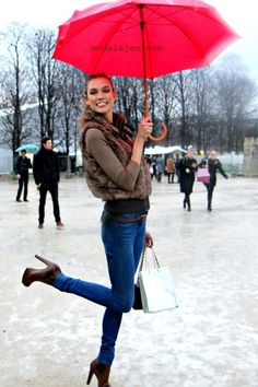 Furry vest, long sleeves, jeans, high heels, and rain...cute outfit for a fall day!