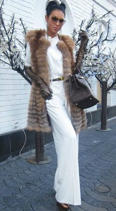A slick up-do teamed with fur, long sleeve glover and sunnies = Glamourpuss! #hairmeetwardrobe #fashion #hair
