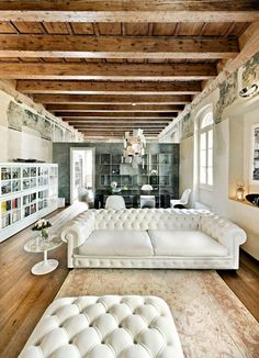 Old and new- love the white leather chesterfield sofa & industrial look