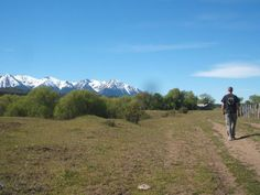 Walking toward their restored ranch house in Argentina.