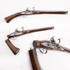"""Beretta Folding Stock Snaphaunce Pistol - A very early example of a firearm designed for concealed carry, this .56 caliber snaphaunce pistol features a folding stock to enable its owner to conceal it under a cloak. When this pistol was made in the 18th century by Beretta, the company had already been honing its craft to perfection for two centuries. This pistol is on display in case 10 of the """"Old Guns in a New World"""" exhibit in the National Firearms Museum in Fairfax, VA."""