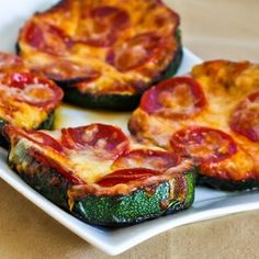 get your pizza fix without the carbs!  grilled zucchini pizza slices.  mmmm!