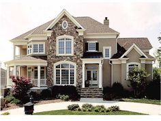 PERFECT. It has everything. Wrap around porch, balcony, stone... Ah.