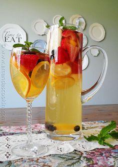 ~SPECTACULAR SANGRIA~ Ingredients:  •1 bottle (750 ml) Gallo Moscato   •1/2 cup orange liqueur (like Triple-Sec)   •1 liter club soda   •1 peach, sliced   •1 medium apple, sliced   •1 orange, unpeeled and sliced   •1 small lemon, unpeeled and sliced   •8-10 medium strawberries, stems removed and halved   •16 blueberries   •16 blackberries   •Fresh mint for garnish (optional)