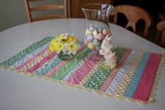 Make Easter table runners with pastel #quilting scraps. All you need is a few strips of fabric in pretty colors to make the Easy Striped Easter Table Runner. Edge the striped runner in ric rac to finish off the sweet #Easter table decoration.