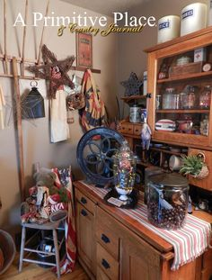Summer 2012, A Primitive Place & Country Journal magazine. The Red, White and Blue room in the home of Leo and Linda Stortenbecker, features a plethora of patrioticthemes and items, such as Americana and old-fashioned, antique American made vintage toys from bygone eras.  Photography by Jeremy A. Doss.